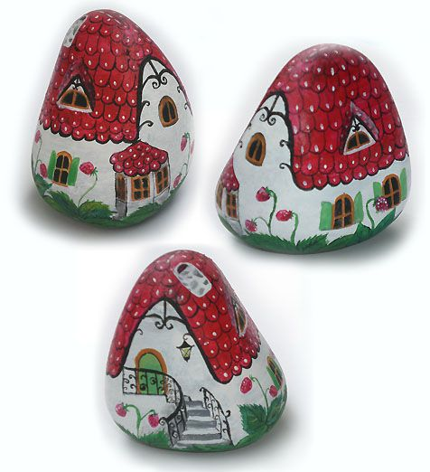 Rocks painted as cute little houses