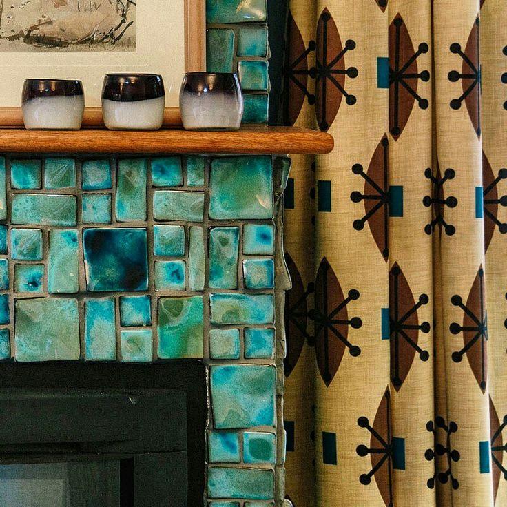 TEXTURE TIME! A close up of our #SputnikMocha #draperyfabric complementing these gorgeous azure glazed tiles on show in this scheme by #AndreaHiggsDesign Adelaide #Australia #furnishingfabric #sputnik #decor #blue #fireplace #curtains #retrofabrics #retro #midcenturymodern #Brisbane #textiledesigner #LynneTanner #interiordesign #midcentury #textures  #madeinaustralia