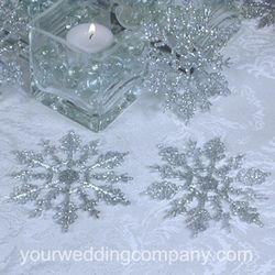 These pretty glittered snowflakes are perfect for winter-themed weddings.  Use them in centerpieces, pew bows or suspend over reception tables with clear nylon thread.