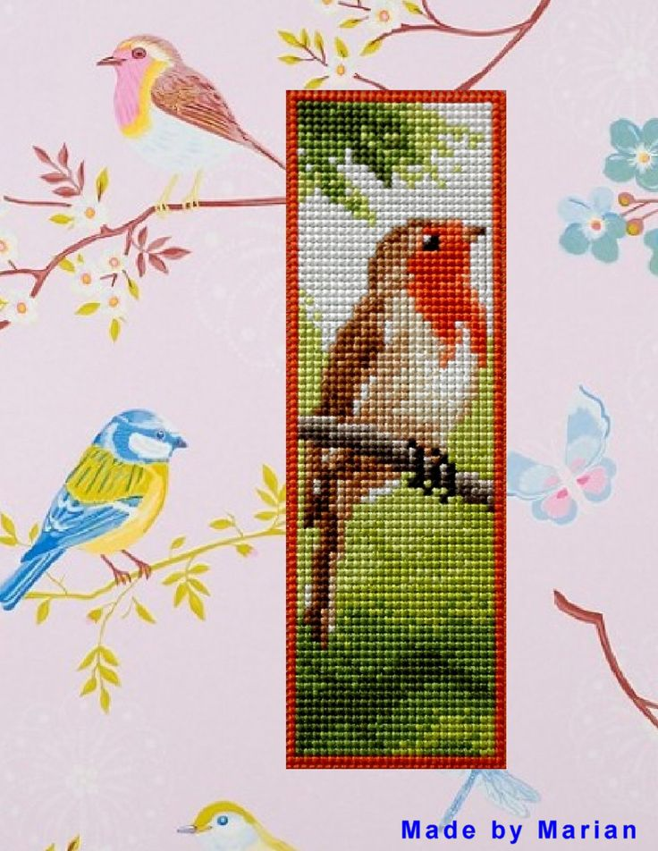 Made by Marian. Bookmark with a bird embroidered on plastic canvas. A 'Vervaco' cross stitch Bookmark kit.