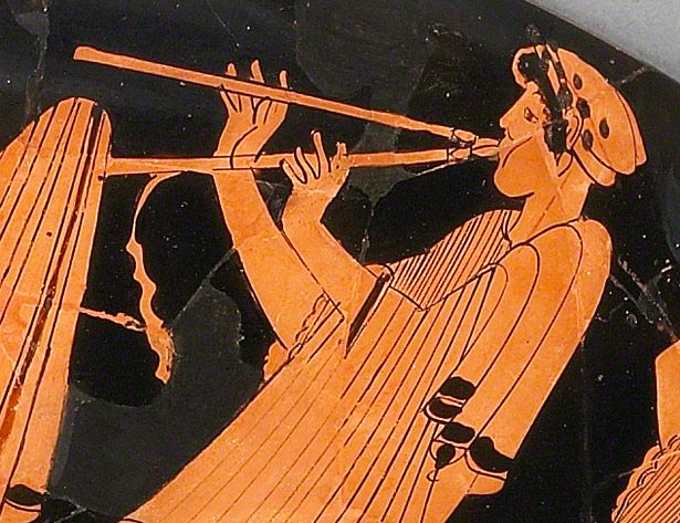Musician plays the aulos on Wine Cup with Flirtation Scene / Briseis Painter, vase-painter, and Brygos, potter