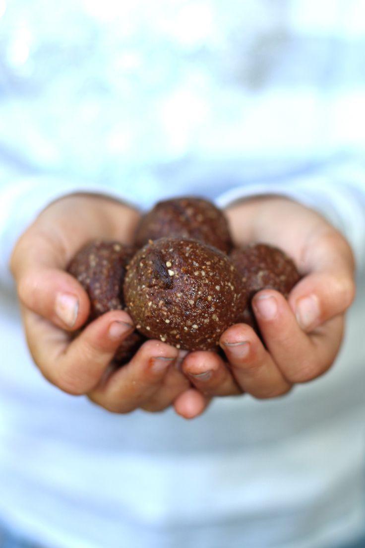 kenz holding bliss balls close up