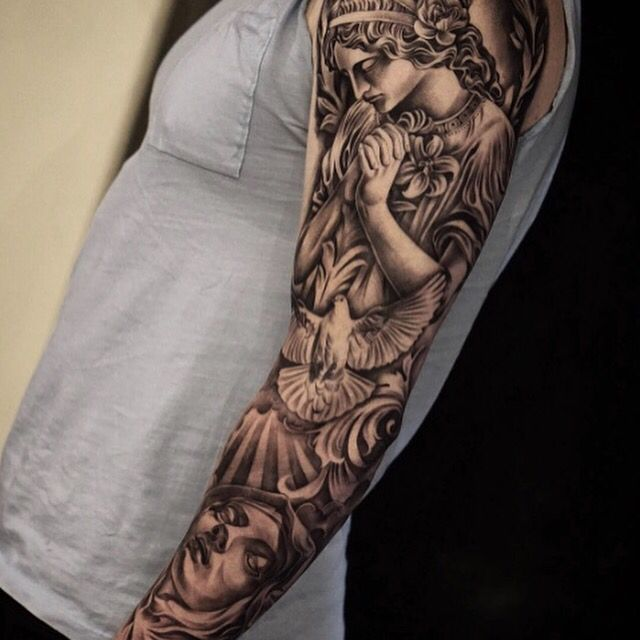 Angel sleeve tattoo artist: Christopher Lee Lowrider Tattoo