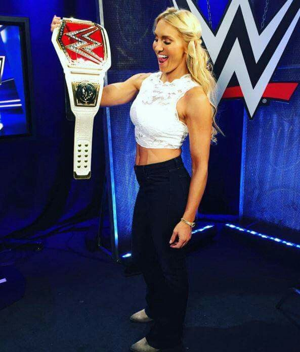 Charlotte: WWE Divas Champion with the New Belt....WWE PPV Payback (May 1, 2016)....Charlotte Flair vs. Natalya Nierdhart....Nattie LOST the match (even with Bret Hart at her corner).