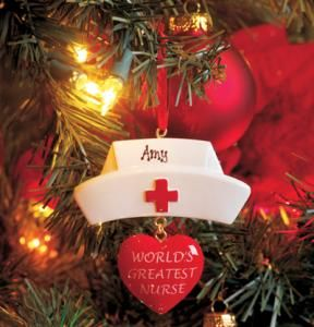 """Can't figure out how to reward the """"World's Greatest Nurse?"""" Let our charming ornament do it for you! Nurse's cap is personalized with name and features a hanging heart with proclamation. 3-1/4""""H x 3""""W."""