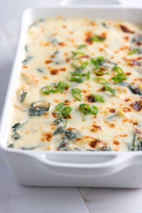 Unbelievably Creamy Spinach Artichoke Dip Recipe from www.inspiredtaste.net #recipe #dip