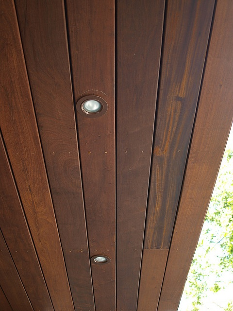 Wood soffits. I like the addition of recessed lighting.