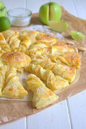 TARTE SOLEIL AUX POMMES (Pour 4 P - 2 rouleaux de pâtes feuilletées, 4 à 5 pommes Grany smith, 1/2 jus de citron, 20 g de beurre, 1 gousse de vanille, 2 à 3 c à s de sucre, 3 c à s de poudre d'amandes, 1 oeuf + 1 pincée de sel pour la dorure, petits sucre perlé, zestes de citron vert (facultatif)