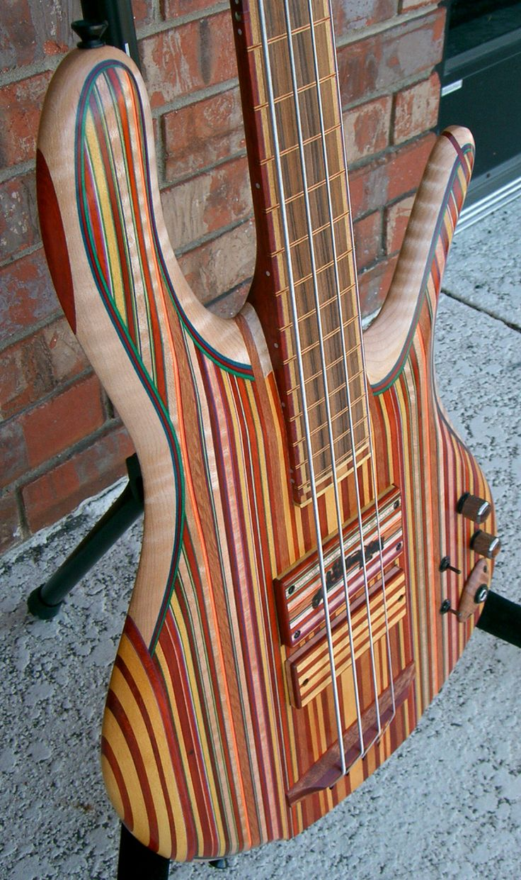 A Carl Thompson guitar with wood tone and yellow stripes body... funky music for a funky instrument. RESEARCH DdO:) - As of 5 Feb 2014 (Carl's birthday!), company no longer taking custom orders which have certificates of authenticity-- Thus customs more rare; future guitars sold as Ready. Intriguing photo pinned via Josue Rivera, Strings.