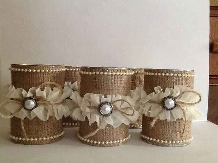 Burlap and lace wrap around tin cans.