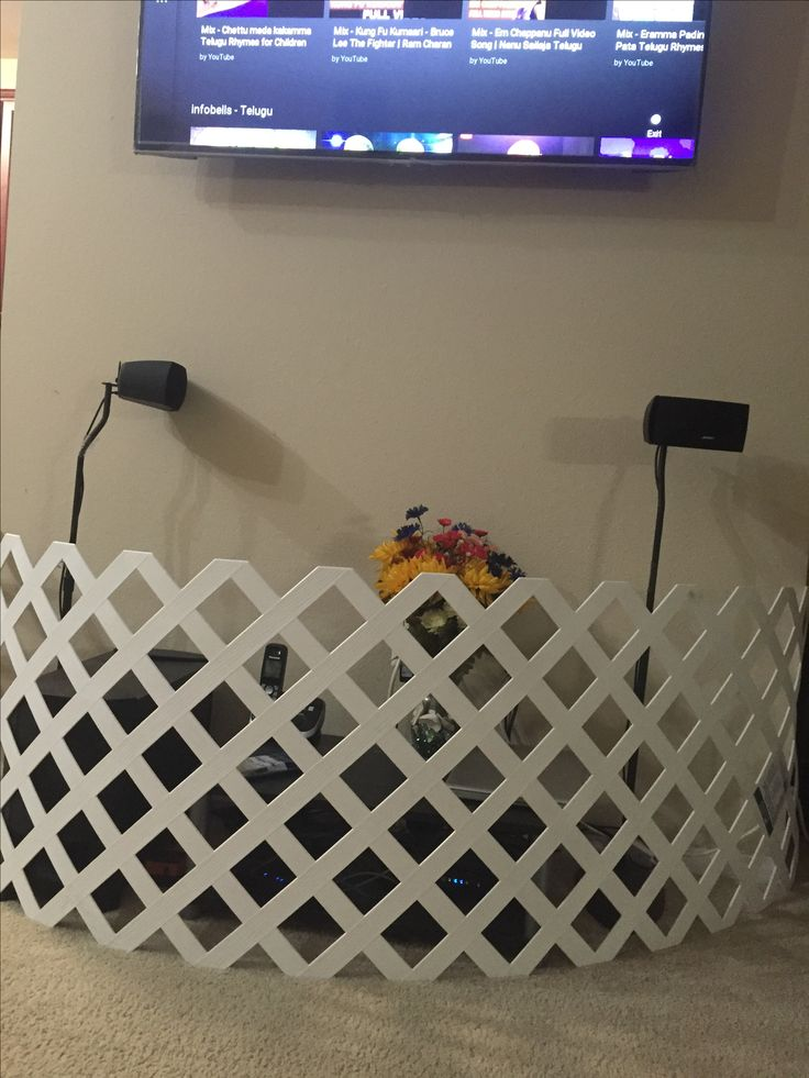 DIY child proofing your TV area .. All you need is a vinyl lattice and screws from Home Depot happy baby proofing