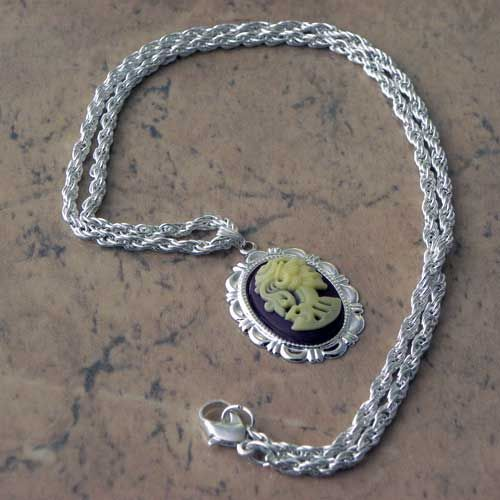 Lolita Lady Death necklace by Gothic White Witch jewellery in cream purple and silver colors Fabulous