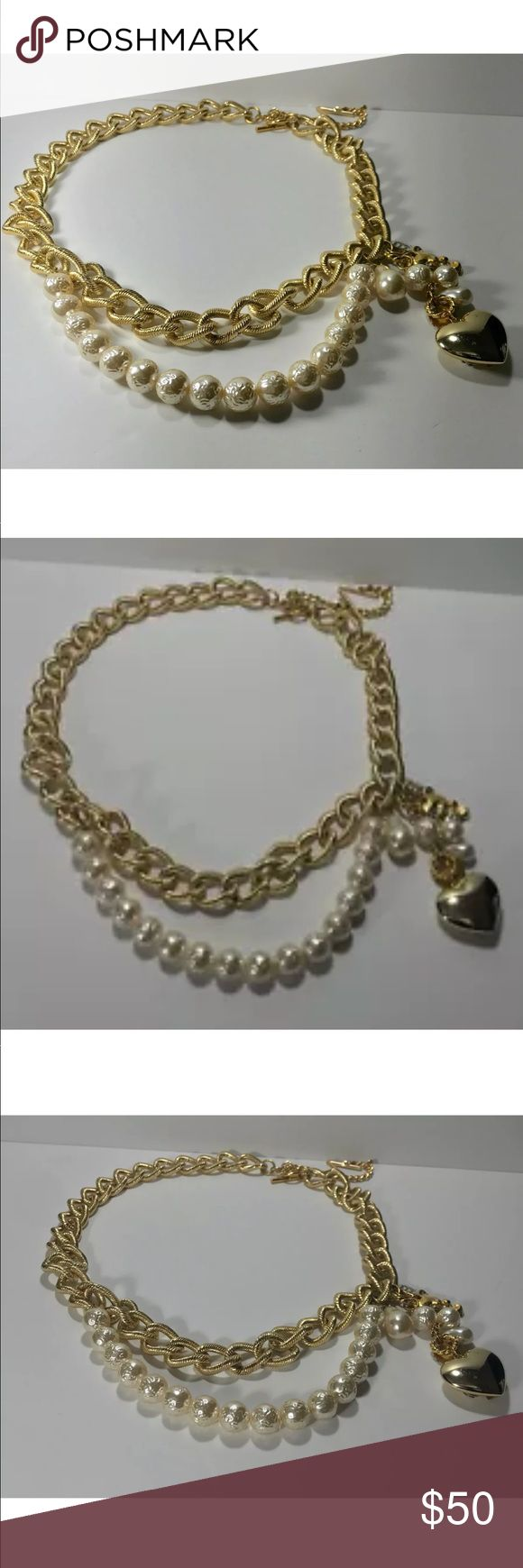 """Chunky gold chain belt w/ pearls and lucky charms This piece is a chunky gold chain belt with pearl accents and hanging lucky charms including a heart, four leaf clover and teddy bear.  It is unmarked  Closes with a toggle and there are three so it is adjustable Total length is  35"""" Can close at 32 and 29"""" Chain is .75"""" wide  Excellent condition This is a really nice, substantial piece.    From clean, non-smoking home. Not from thrift or garage sale. My client is the original owner…"""