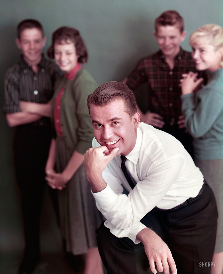 """American Bandstand: 1959 ....1959. """"American Bandstand emcee Dick Clark with teenagers on the set of the show."""" From color transparencies by Phillip Harrington and Howell Conant for the Look magazine assignment """"Dick Clark Talks to Teenagers."""""""