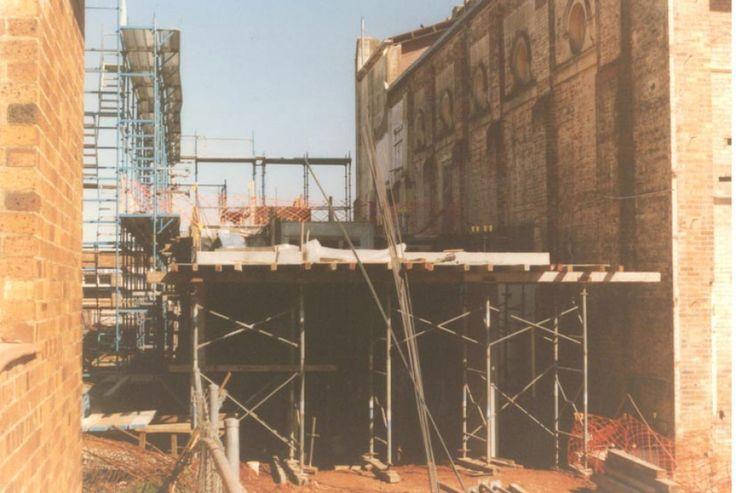 The original brick walls were preserved when the rebuild happened