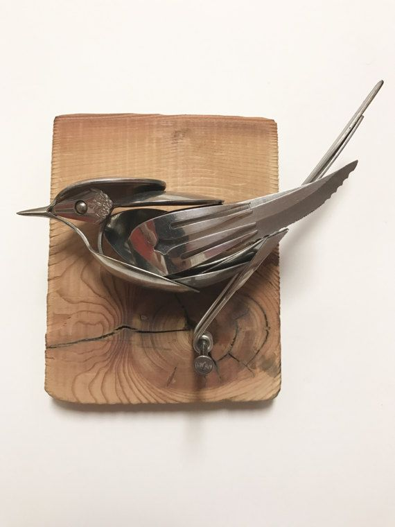 Bird made from upcycled utensils and scrap metal mounted on reclaimed wood. Sherri Sherwin