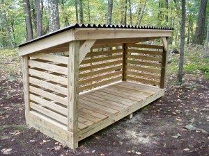 Firewood Storage-  repurpose some of those pallets...for trash cans and wheel barrow...