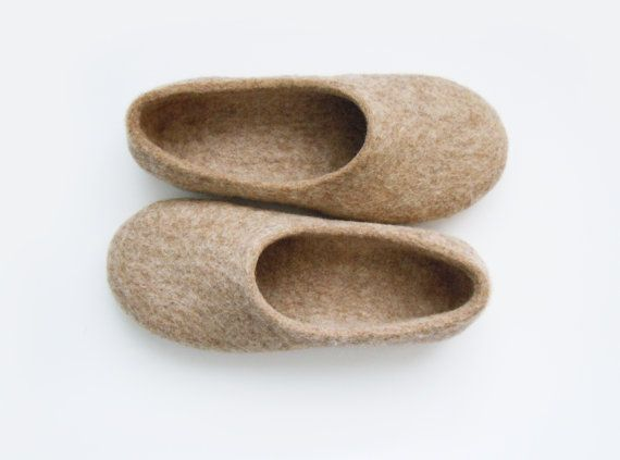 Eco friendly handmade felted slippers in natural light brown color.