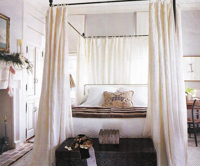 a graceful iron canopy bed lends romance to the master bedroom and white embroidered - Gotische Himmelbettvorhnge