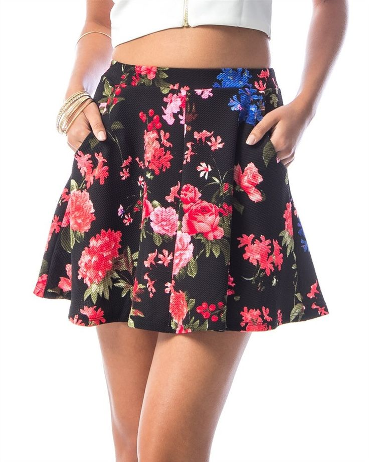 This super cute skirt is comfortable and a great wear for this Spring and Summer. - A-lined skirt - Double front pockets - Flower prints - Elastic waist - Made in the USA Color: Black, Pink. Please ke