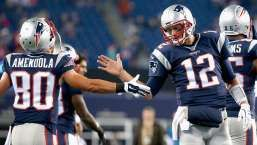 FOXBORO, MA - OCTOBER 29:  Tom Brady #12 of the New England Patriots high fives Danny Amendola #80 before a game against the Miami Dolphins at Gillette Stadium on October 29, 2015 in Foxboro, Massachusetts.  (Photo by Jim Rogash/Getty Images)