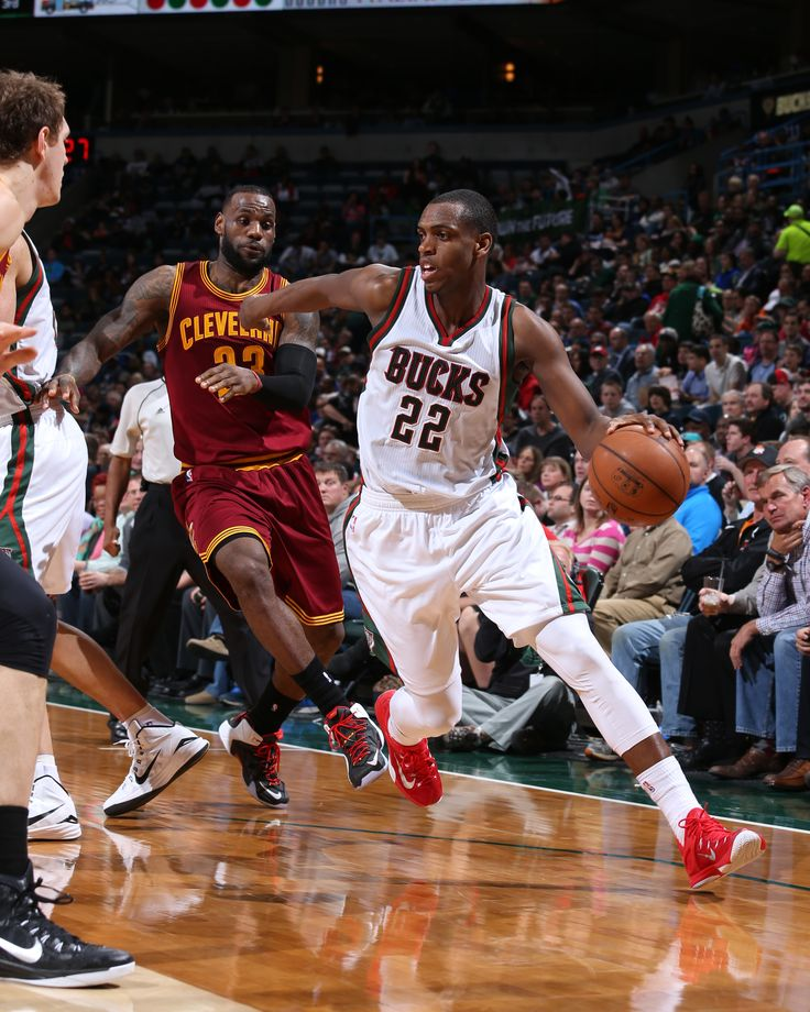 Khris Middleton #22 of the Milwaukee Bucks handles the ball against the Cleveland Cavaliers on April 8, 2015 at BMO Harris Bradley Center in Milwaukee, Wisconsin.  (Photo by Gary Dineen/NBAE via Getty Images)