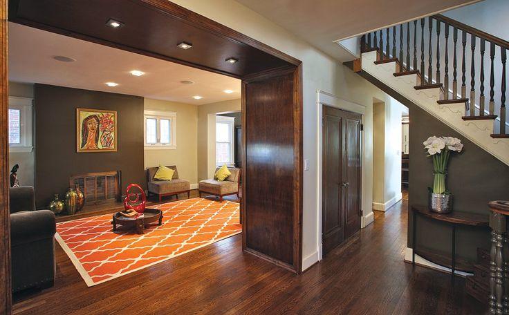 Square walnut arches define the livingroom entry interior design de