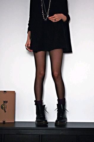 Girl wearing a black dress (or oversized sweater) with a necklace, stockings and black Doc Martens #DocMartens #DrMartens