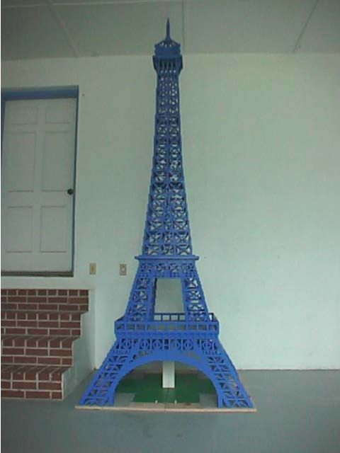 Yes, it's the Eiffel Tower.  Yes, it's blue.  It's about 12 feet tall.  No, there is no glue holding it together.