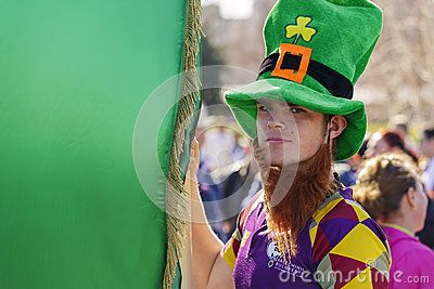 St. Patricks Day Parade. Young man wearing traditional Irish green hat holds large green flag during the 2nd St. Patricks Day Parade on March 16, 2014 in Bucharest, Romania. Download this Editorial Stock Image of St. Patricks Day In Bucharest, Romania. for as low as 0.68 lei. New users enjoy 60% OFF. 22,147,250 high-resolution stock photos and vector illustrations. Image: 38899394