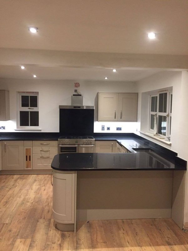 This kitchen consists of the beautiful Cosmico Nero black style quartz. It has been chosen to finish this traditional style kitchen with the perfect breakfast bar on the end.