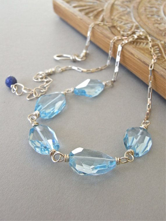 The Blue Skies Forever necklace - gorgeous blue faceted topaz and bright sterling combine in this simple and elegant design.