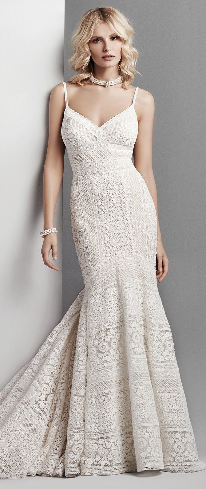 This sexy boho wedding dress features patterns of eyelet lace in a fit-and-flare silhouette. Spaghetti straps complete the V-neckline and V-back. Lined with Viva Jersey for a luxe fit. Finished with zipper closure.