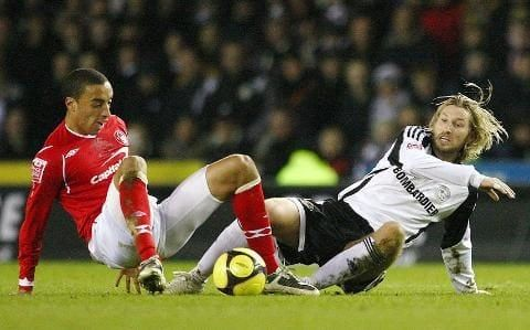 Derby's Robbie Savage fights for the ball