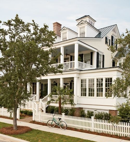 Fabulous!Double porches, picket fence, dormers, metal roof, sunroom <3