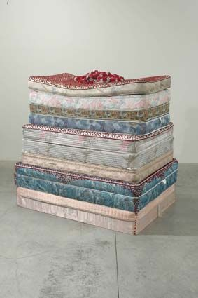 Rogue Wave '05: Rodney McMillian Cake, 2005 mattresses, acrylic paint, artificial flowers