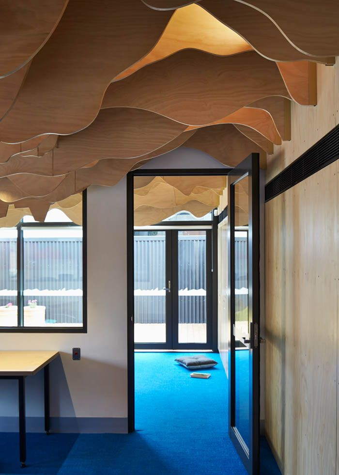 Transition between the office and the Children's room in the Cubbyhouse at Broadmeadows Children's Court with an up-side-down cityscape and landscape ceiling sculpted out of timber fins | Cubbyhouse by Mihaly Slocombe (2014-15) | Broadmeadows, Victoria, Australia  | Photo: Peter Bennetts