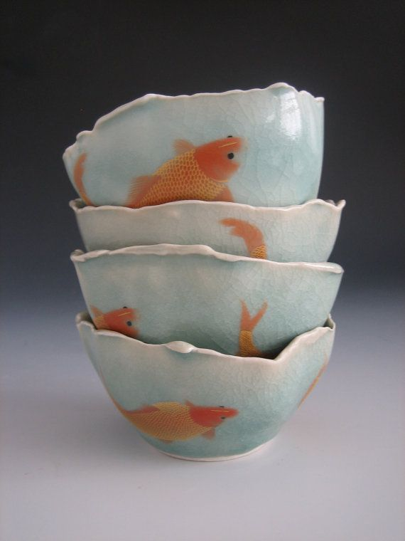 These delicate bowls are adorned with goldfish decals, which I discovered while doing an art residency near Jingdezhen, China. Bowls are glazed with a