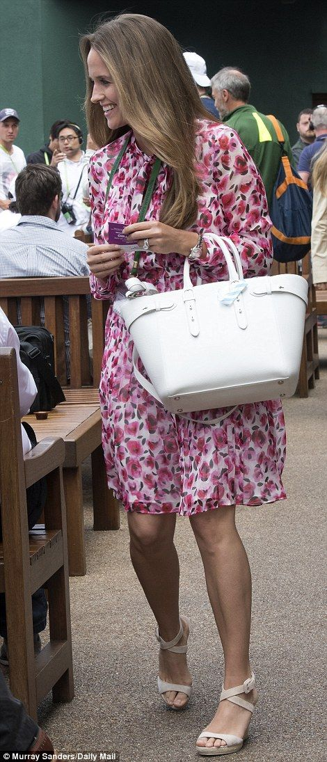 Kim Murray teamed her Kate Spade print dress with an £850 bag by Aspinal of London