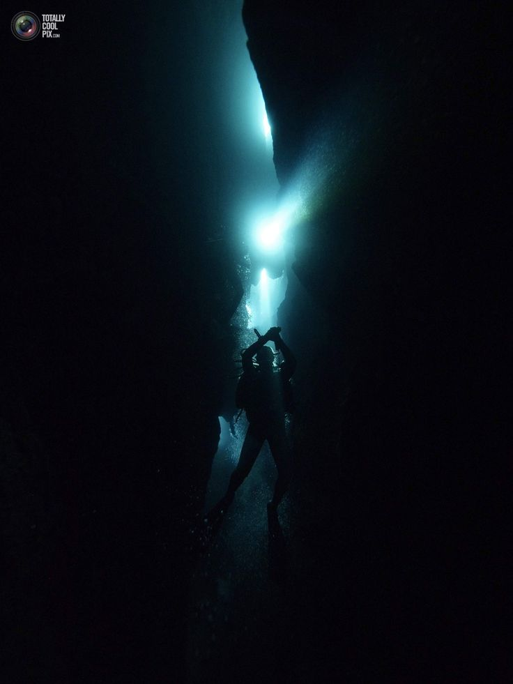 A scuba diver enters a cave in La Cueva de los Peces (Cave of the Fish) along the coast of Playa Giron, near the Bay of Pigs, 160 km (99 miles) south-east of Havana, in central Cuba January 24, 2012. The Arab Spring, changes in U.S. policy and economic reforms at home are driving a tourist rush that is giving communist-run Cuba one of its best seasons ever and stretching its ability to accommodate demand. Cuba just completed its best year for tourism with 2.7 million visitors in 2011, and…