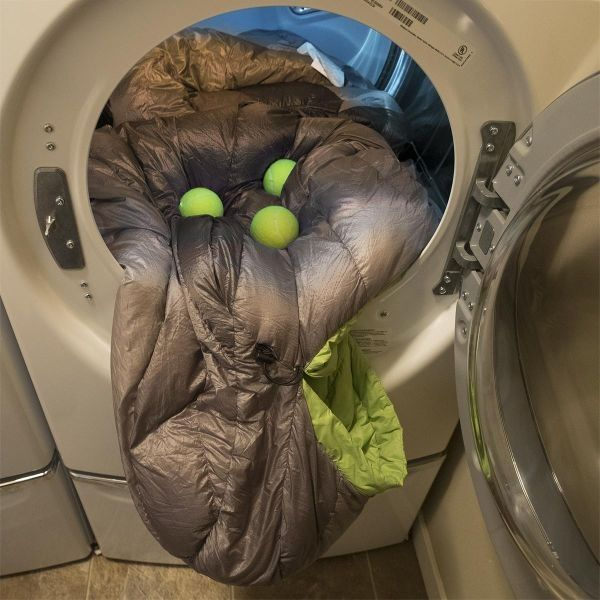 Use tennis balls when drying down sleeping bags and comforters. This really does keep them fluffy. :)