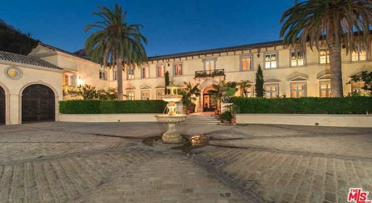 This Tuscan style mansion is located at 75 Beverly Park Lane in the exclusive guard-gated Beverly Park community in Beverly Hills, California and is situated on 5 acres of land.
