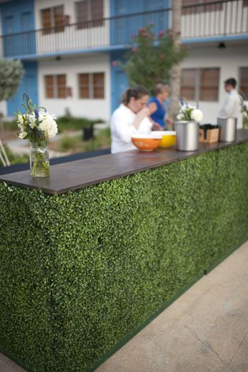 Custom built bars with a botanical look! Covered in artificial hedging