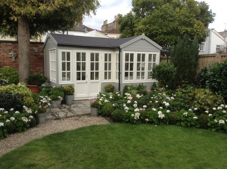 The Summerhouse exterior walls painted in a 50/50 mix of Cuprinol silver Birch and Country Cream, with a touch of Cuprinol Jasmine. (This gives a very similar colour to Farrow and Ball Lamproom Gray) windows and doors in Dulux Jasmine White water based opaque paint.