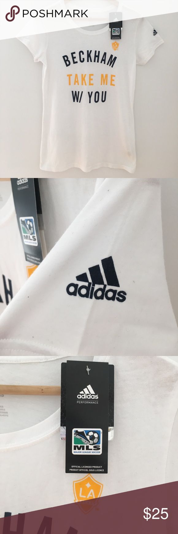 "NWT- Authentic Adidas MLS ""Beckham"" Tee This Adidas women's fitted t-shirt is from David Beckham's last game with MLS & the LA Galaxy. It says, ""Beckham Take Me W/ You"".  It is new with tags. Purchased at the stadium during the MLS Cup game in LA. Authentic collectors shirt. Brand new with tags. Perfect condition. Comes from a clean, non-smoking home. adidas Tops Tees - Short Sleeve"