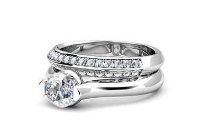 White gold solitaire and channel set white wedding band in white gold by T & T Jewellers.