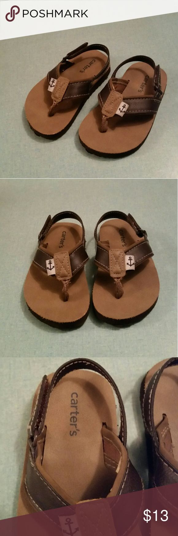 Carter's Brown Leather Boys Toddler Flip Flops Carter's Brown faux leather flip flops with velcro slip-on strap Size 6 Toddler boys From tip of toe to heel is 6 inches long Pre~owned, only wore once, in excellent condition Carter's Shoes Sandals & Flip Flops