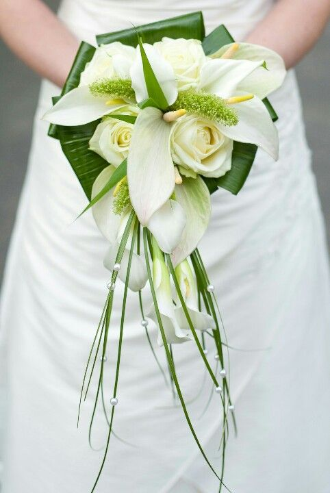 Something a little different...white anthurium, roses, mini callas, bear grass with pearls and folded aspidistra leaves