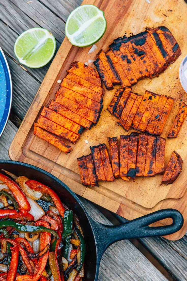 "Grilled sweet potato ""steaks"", roasted peppers and onions, and a New Mexican chile marinade, these vegan campfire fajitas are a new take on an old classic."