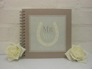 Mr & Mrs Guest Book or Scrap Book £16.99 A beautiful East of India 'Mr & Mrs' guest book or Scrap Book, festures a plaque on the front with a horseshoe shape and the words 'Mr & Mrs. The Guest-Scrap book is blank inside with 15 pages of card, the front and back cover is a high quality thick grey card, a lovely accessory for the big day! Dimensions Approx: H: 21.5cm x W: 22.5cm x D: 1.5cm #scrapbook #weddings
